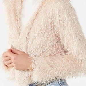 Blush jacket with just the amount of fringe